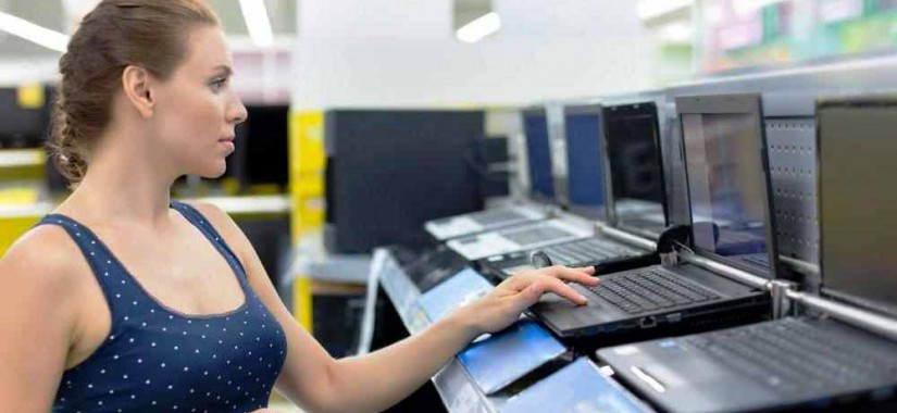 woman-looking-at-laptops-in-store